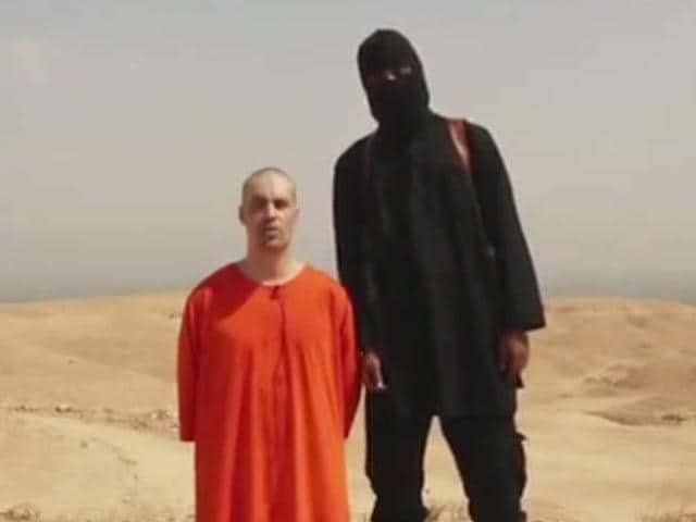 This-photo-is-a-frame-from-the-video-released-by-ISIS-militants-that-shows-the-purported-beheading-of-US-journalist-James-Foley-who-has-been-missing-since-2012-AP-Photo