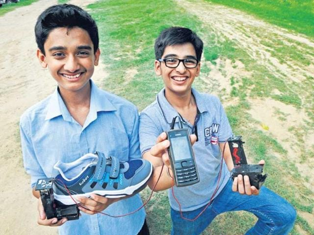 Anand-Gangadharan-left-and-Mohak-Bhalla-with-their-portable-shoe-mobile-phone-charger-HT-photo