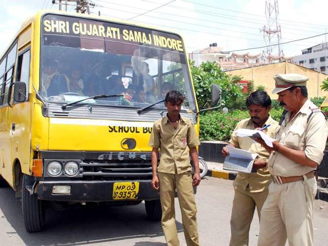 Policemen-check-school-buses-for-overriding-and-other-facilities-in-Indore-recently-Arun-Mondhe-HT-file-photo