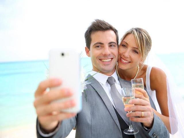 A-couple-taking-a-selfie-Shutterstock
