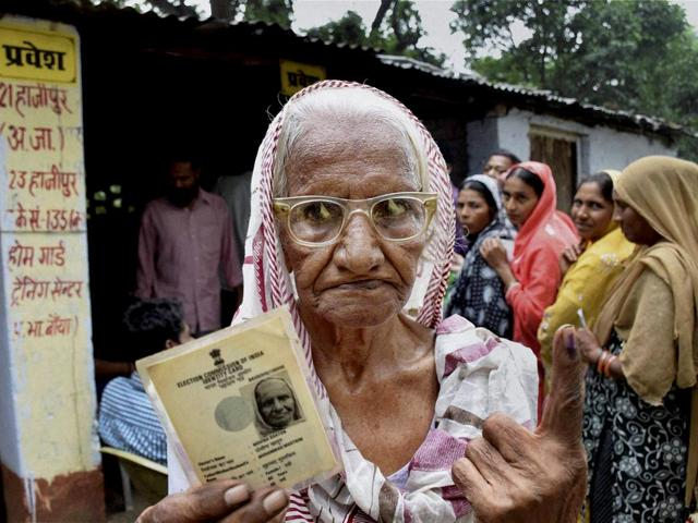 An-elderly-voter-shows-her-identity-card-after-casting-her-vote-in-Hajipur-during-bypolls-for-10-assembly-seats-in-Bihar-PTI-Photo