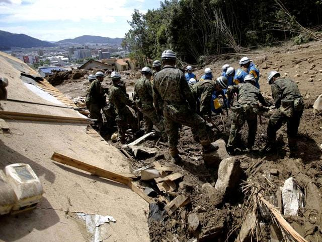 Japan-Self-Defense-Force-JSDF-soldiers-and-police-officers-search-for-survivors-at-a-site-where-a-landslide-swept-through-a-residential-area-at-Asaminami-ward-in-Hiroshima-western-Japan-Reuters-Photo