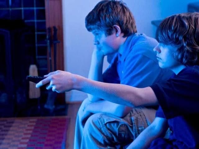 Sleepless-teens-watching-TV-AFP