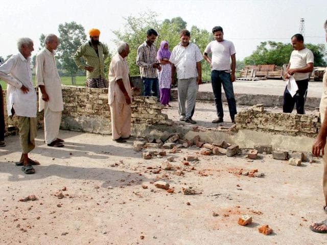 Villagers-show-marks-of-mortar-shells-after-firing-from-Pakistan-s-side-in-Treva-village-at-India-Pakistan-International-border-in-Arnia-Sector-Jammu-PTI-Photo