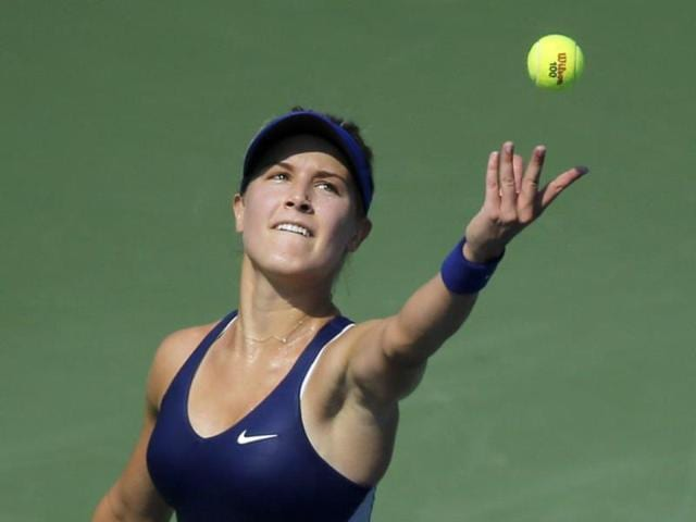 Eugenie-Bouchard-of-Canada-tosses-the-ball-as-she-serves-to-Olga-Govortsova-of-Belarus-during-the-2014-US-Open-women-s-singles-match-at-the-USTA-Billie-Jean-King-National-Tennis-Center-AFP-Photo