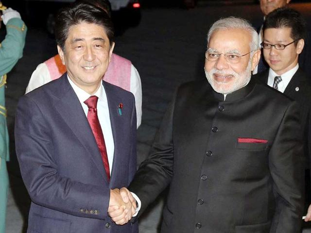 Prime-Minister-Narendra-Modi-front-R-shakes-hands-with-Japan-s-Prime-Minister-Shinzo-Abe-upon-his-arrival-at-the-State-Guest-House-in-Kyoto-western-Japan-Reuters-Kyodo-Photo
