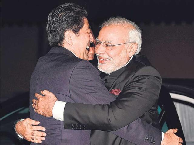 Japanese-Prime-Minister-Shinzo-Abe-gives-PM-Narendra-Modi-a-big-hug-on-arrival-at-the-state-guest-house-in-Kyoto-on-Saturday