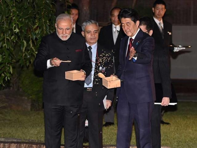 Prime-Minister-Narendra-Modi-L-and-his-Japanese-counterpart-Shinzo-Abe-front-R-feed-carp-next-to-the-garden-pond-of-the-State-Guest-House-in-Kyoto-western-Japan-AFP-Photo