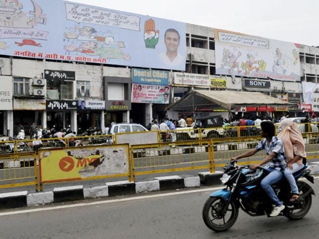 The-Congress-is-using-cartoons-to-target-the-ruling-BJP-Huge-hoardings-have-been-put-up-at-Roshanpura-in-Bhopal-Mujeeb-Faruqui-HT-photo