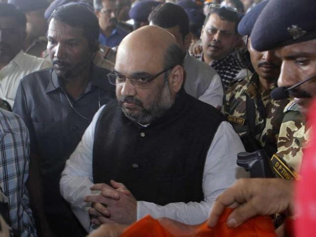 The Mumbai-born BJP chief Amit Shah was given a tumultuous welcome by thousands of party activists and top leaders at the Mumbai airport. (PTI photo)