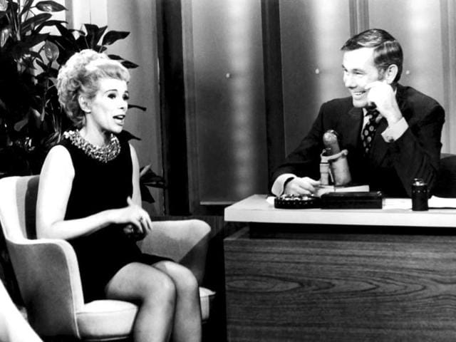 This undated image released by NBC shows comedian Joan Rivers, left, and host Johnny Carson during The Tonight Show Starring Johnny Carson. The raucous, acid-tongued comedian who crashed the male-dominated realm of late-night talk shows and turned Hollywood red carpets into danger zones for badly dressed celebrities, died Thursday. (AP)