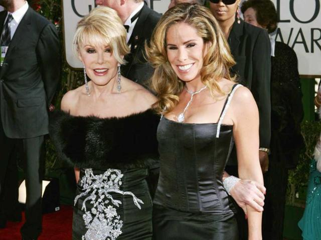 In this January 16, 2005 file photo, comedian Joan Rivers, left, and her daughter, Melissa, from the TV Guide Channel pose on the red carpet during arrivals at the 62nd annual Golden Globe Awards in Beverly Hills. (AP)