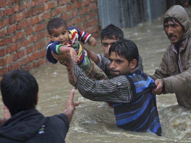 Boy-being-rescued-in-flood-hit-Kashmir