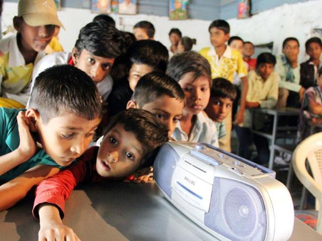 Students of Government Urdu School, Bombay Bazaar, in Indore had to remain content with hearing PM Narendra Modi's Teacher's Day speech on radio. (Arun Mondhe/HT photo)