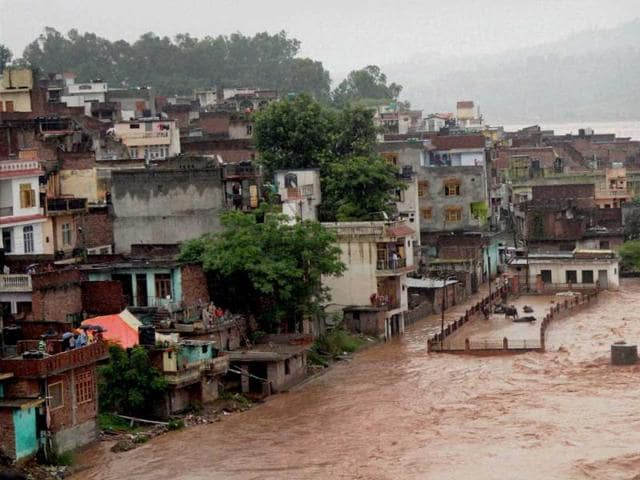 A view of residential areas adjoining Tawi river during heavy rains in Jammu. (PTI Photo)