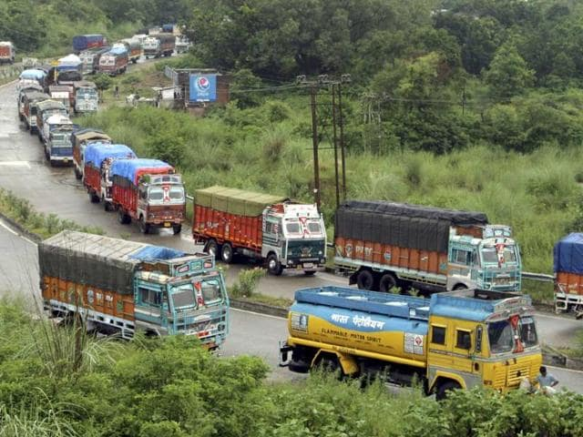 Trucks stands stranded due to heavy rain fall in Jammu. (HT Photo/Nitin Kanotra)