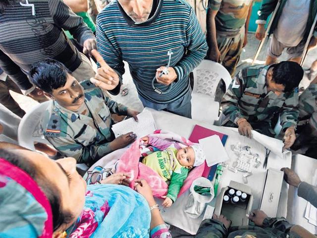 Army-doctor-check-a-10-month-old-at-a-medical-camp-in-Hyderpora-Raj-K-Raj-HT-Photo