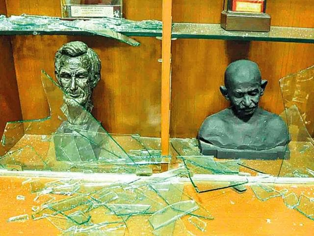 Activists-of-the-Vishwa-Hindu-Parishad-and-Bajarang-Dal-vandalise-statues-at-Vikram-University-in-Ujjain-on-Monday-HT-Photo