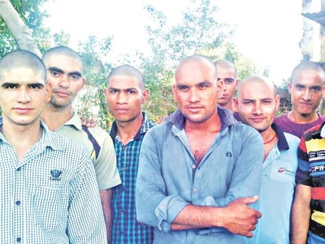Some-of-the-youngsters-at-Dakachya-village-in-Sanwer-tehsil-in-Indore-who-had-their-heads-tonsured-to-ward-off-the-ill-omen-caused-by-the-death-of-a-monkey-within-the-village-s-boundaries-HT-Photo