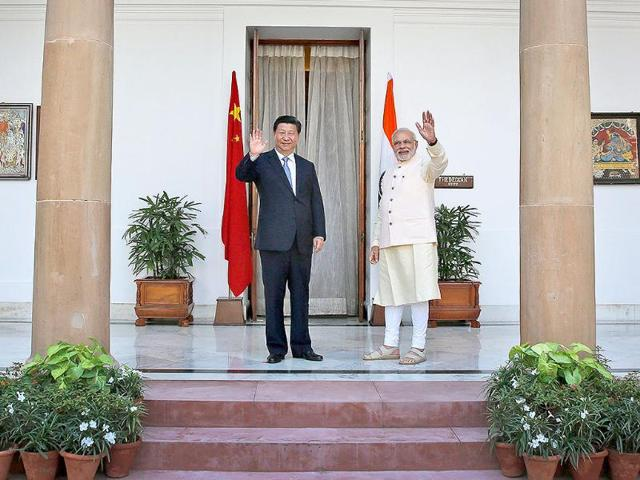 PM-Modi-and-Xi-Jinping-before-a-meeting-in-New-Delhi-on-Thursday-Xi-and-Modi-will-hold-talks-aimed-at-boosting-trade-and-Chinese-investment-even-as-their-troops-face-off-along-their-disputed-border-in-the-Himalayas-AP-Photo