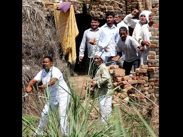 RLD-supporters-pelting-brick-bats-towards-policemen-during-a-protest-against-the-Union-government-over-the-cut-off-of-electricity-from-party-leader-Ajit-Singh-s-official-bungalow-following-repeated-eviction-notices-PTI-Photo