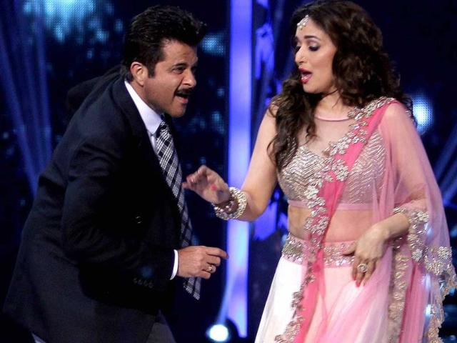 Anil Kapoor dances with Madhuri Dixit during the grand finale of the television dance reality show Jhalak Dikhhla Jaa Season 7. (AFP Photo)
