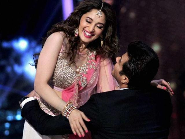 Anil Kapoor wooes he gorgeous Madhuri Dixit with his dance moves during the grand finale of Jhalak Dikhhla Jaa 7. (PTI Photo)