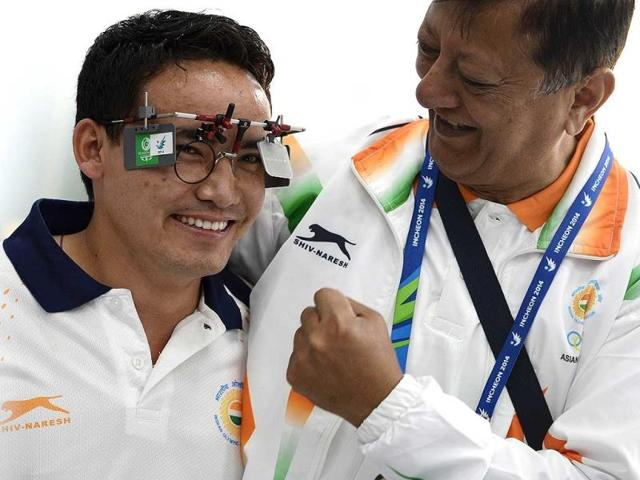Jitu-Rai-L-celebrates-with-a-team-official-after-winning-the-men-s-50m-air-pistol-individual-final-of-the-2014-Asian-Games-in-Incheon-South-Korea-AFP-Photo