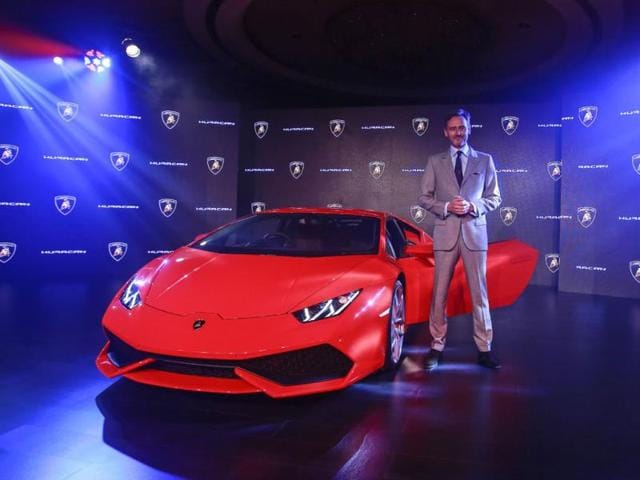 Sebastien-Henry-Head-Automobili-Lamborghini-South-East-Asia-and-Pacific-poses-with-the-Huracan-LP-610-4-during-its-launch-ceremony-in-Mumbai-September-22-2014-The-price-of-the-Huracan-will-start-from-Rs-34-300-000-rupees-563-983-for-the-base-model-according-to-the-press-release-Photo-Reuters