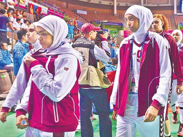 Qatar-women-s-basketball-team-leaves-the-court-after-forfeiting-their-match-against-Mongolia-in-the-2014-Asian-Games-in-Incheon-South-Korea-Reuters-Photo