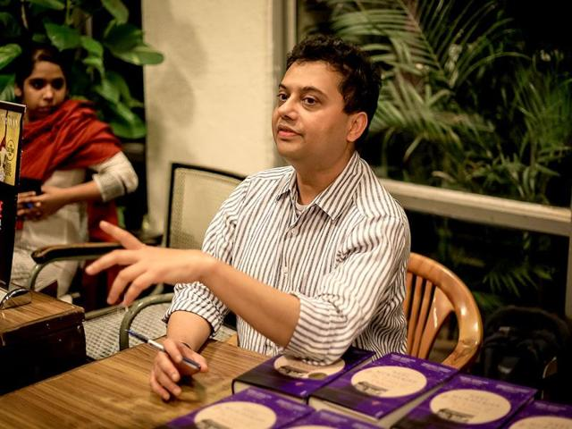 Neel-Mukherjee-signs-copies-of-The-Lives-of-Others-and-interacts-with-readers-Abhishek-Saha-HT-Photo