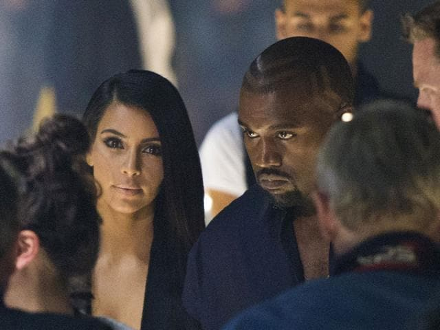 Kim-Kardashian-and-Kanye-West-arrive-at-the-presentation-of-Lanvin-s-Spring-Summer-2015-ready-to-wear-fashion-collection-presented-in-Paris-France-Thursday-Sept-25-2014--AP-Photo