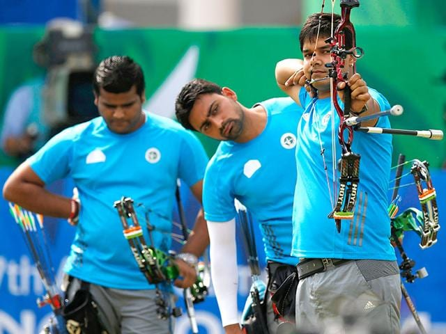 India-s-Abhishek-Verma-shoots-as-teammates-Sandeep-Kumar-and-Rajat-Chauhan-watch-during-their-men-s-compound-team-gold-medal-archery-match-against-South-Korea-Reuters-Photo