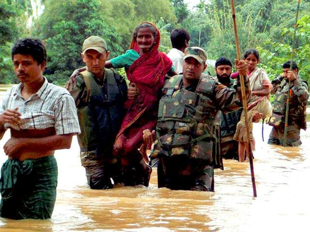 Army-jawans-rescue-flood-affected-people-at-Chaigaon-in-Kamrup-PTI-Photo