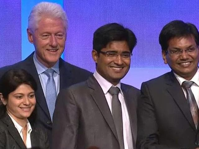 Aditi-Vaish-first-from-left-with-former-US-President-Bill-Clinton-and-team-members-of-Nano-Health-in-New-York-HT-photo