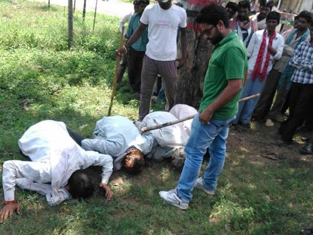 Surendra-Singh-Rajpurohit-alias-Tiger-forcing-villagers-to-bow-their-heads-before-him-in-Harda-HT-file-photo