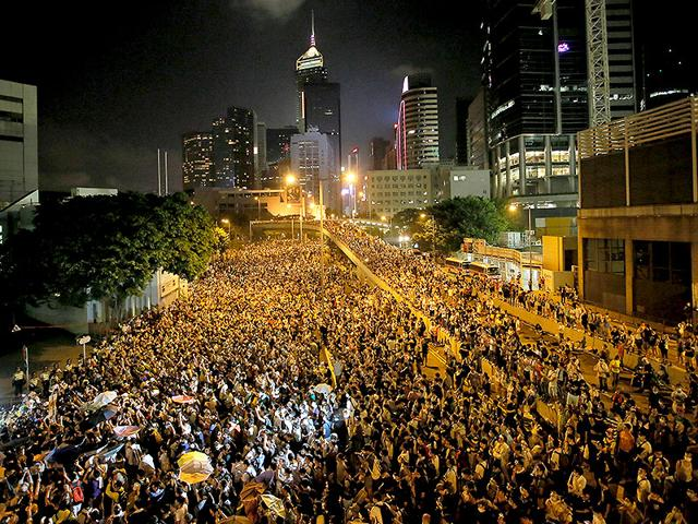 Protesters-gather-at-a-main-road-at-the-financial-central-district-after-riot-police-use-tear-gas-against-them-after-thousands-of-people-blocked-the-road-in-Hong-Kong-AP-Photo