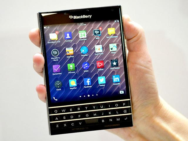 A-woman-holds-the-Blackberry-Passport-smartphone-during-at-a-simultaneous-launch-event-in-London-AFP-Photo