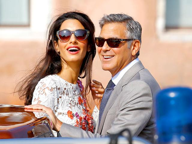 US-actor-George-Clooney-and-British-lawyer-Amal-Alamuddin-arrive-at-the-palazzo-Ca-Farsetti-in-Venice-for-a-civil-ceremony-to-officialise-their-wedding-The-ceremony-was-short-lasting-just-about-12-minutes-Photo-AFP--Pierre-Teyssot