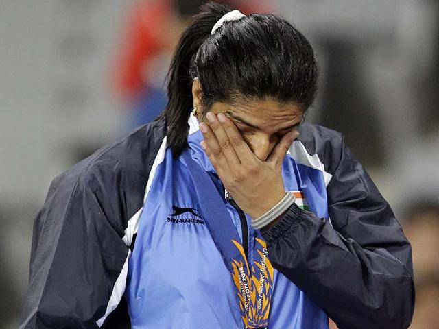 Seema-Punia-wipes-her-tears-after-receiving-the-gold-medal-for-women-s-discus-throw-at-the-17th-Asian-Games-in-Incheon-South-Korea-AP-Photo