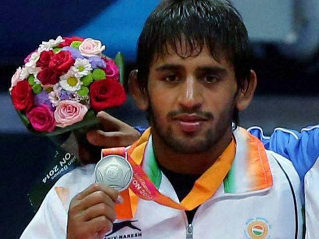 Bajrang-Kumar-poses-after-winning-the-Silver-medal-in-61-kg-freestyle-wrestling-match-at-Asian-Games-in-Incheon-on-Monday-PTI-Photo