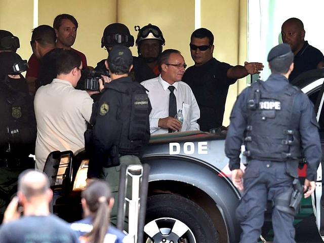 A-hotel-employee-centre-white-shirt-who-was-held-hostage-and-forced-to-wear-an-explosive-laden-vest-is-driven-out-from-the-hotel-in-Brasilia-AFP-Photo