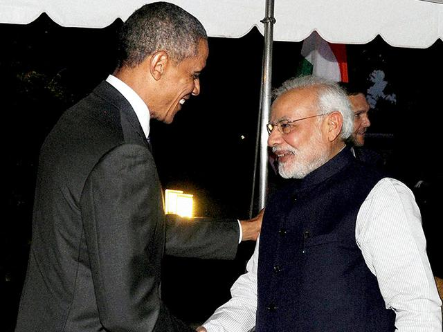 US-President-Barack-Obama-greets-Narendra-Modi-at-the-White-House-US-chamber-of-commerce-that-had-cross-haired-India-for-its-trade-and-patent-practices-has-signalled-willingness-to-work-with-the-Modi-government-PTI-photo