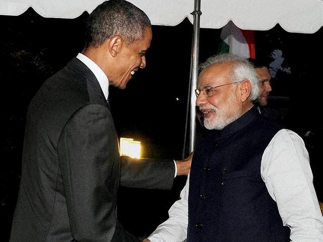 US-President-Barack-Obama-welcomes-Prime-Minister-Narendra-Modi-at-the-dinner-hosted-in-his-honour-at-the-White-House-in-Washington-PTI-Photo