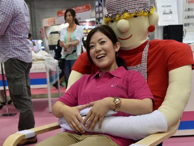 An-employee-of-Japan-s-nursing-care-goods-maker-Unicare-demonstrates-an-easy-chair-for-congnitively-empaired-persons-at-the-annual-International-Home-care-and-Rehabilitation-exhibition-in-Tokyo-AFP