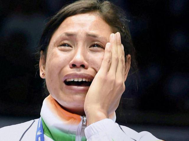 Bronze-medallist-Laishram-Sarita-Devi-reacts-during-the-medal-ceremony-for-the-women-s-light-boxing-competition-at-the-Seonhak-Gymnasium-during-the-2014-Asian-Games-in-Incheon-Reuters-Photo