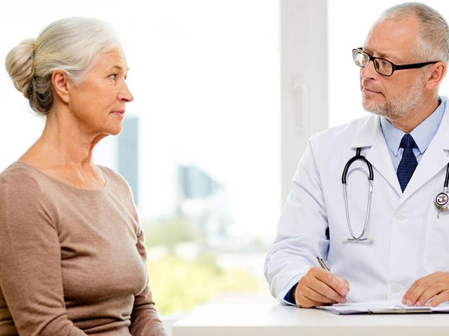 Woman-consulting-a-doctor-Photo-Shutterstock