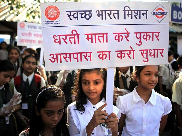 School children hold placards to support PM Modi