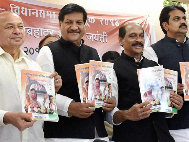 Congress-leaders-Sushilkumar-Shinde-Prithviraj-Chavan-Manikrao-Thakre-and-Harshvardhan-Patil-launch-the-party-s-election-manifesto-for-the-upcoming-Maharashtra-assembly-polls-in-Mumbai-PTI-photo