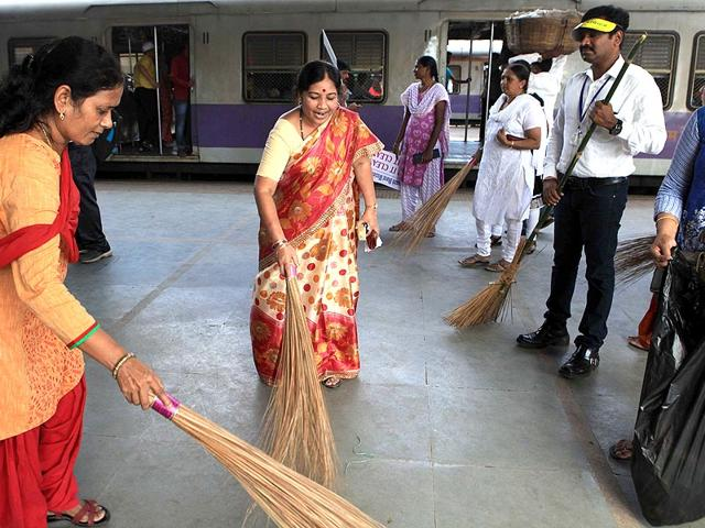 Railway staff members clean a railway station platform in Borivali. Prime Minister Narendra Modi launched the Swachh Bharat campaign on October 2 in an effort to clean the entire country by October 2, 2019, which marks Mahatma Gandhi